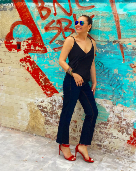 black tank jeans and red heels
